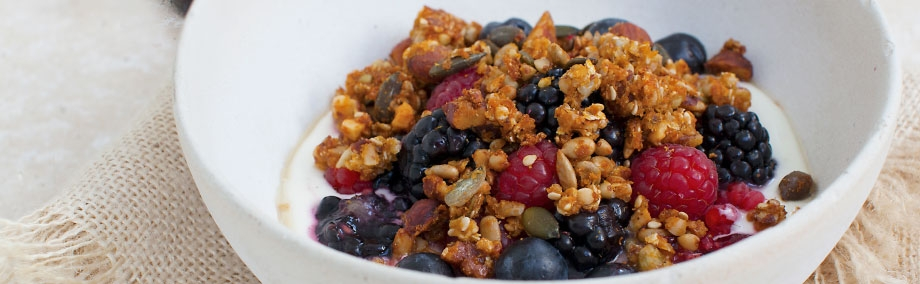 Ancient Grain Granola With Berry Yogurt & Udo's Oil Drizzle